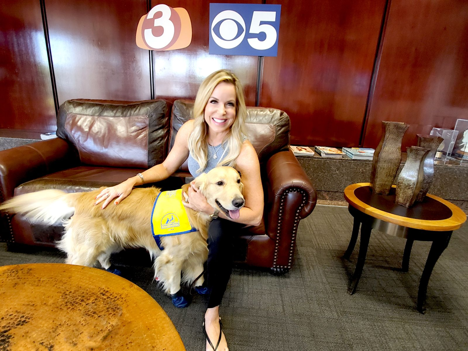 News Caster woman with Canine Companions puppy